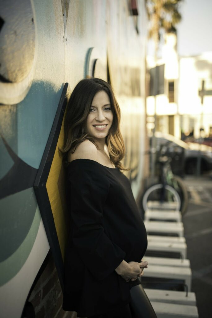 Los Angeles based ArtShaped photography photographs a pregnant mother with the colorful graffiti of Venice, California.