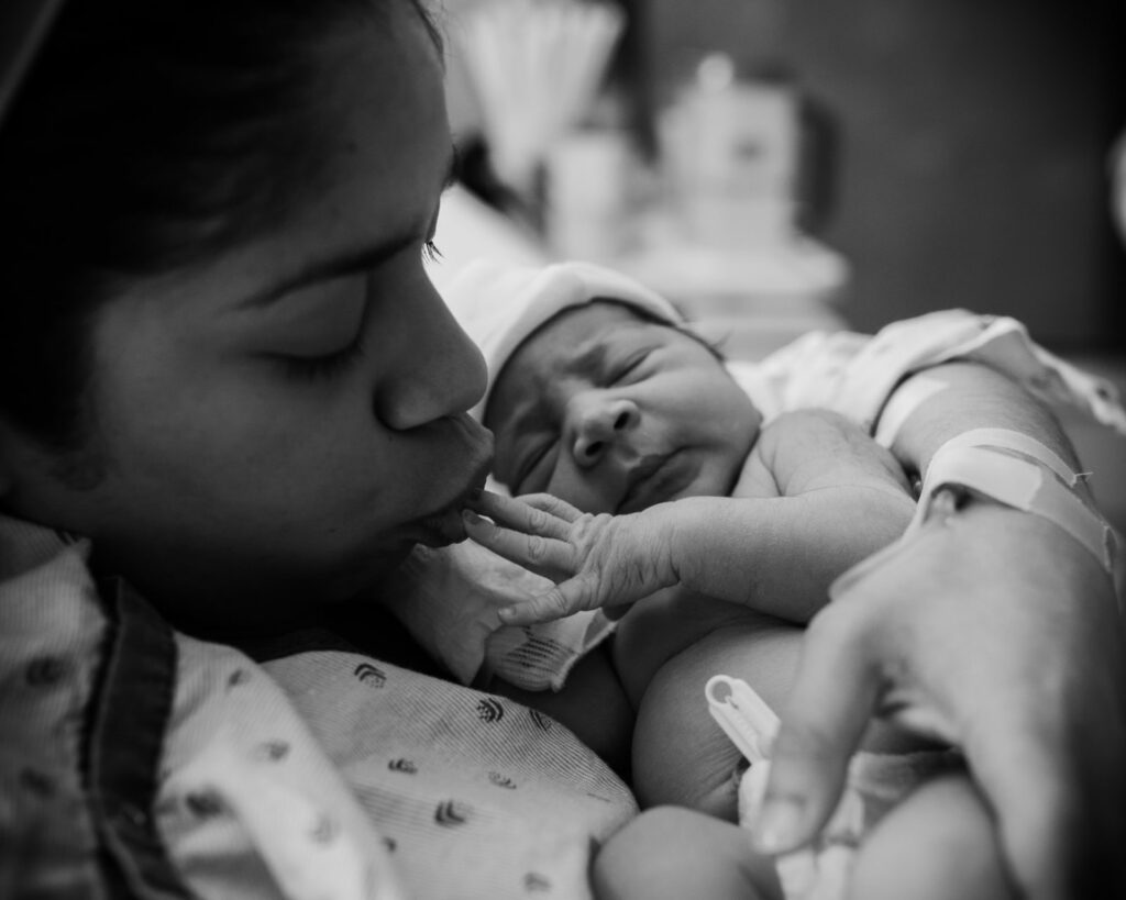 As shown in this black and white image captured by Los Angeles based Artshaped photography mom steals an intimate moment with her baby daughter while appreciates the tiny details of her fingers.