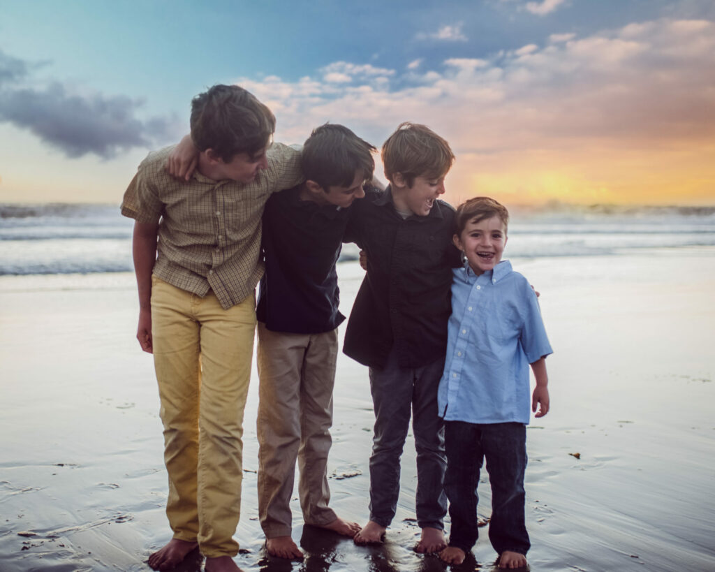 As colorful as the sunset these four boys playfully pose for Santa Monica based family photographer Artshaped Photography.
