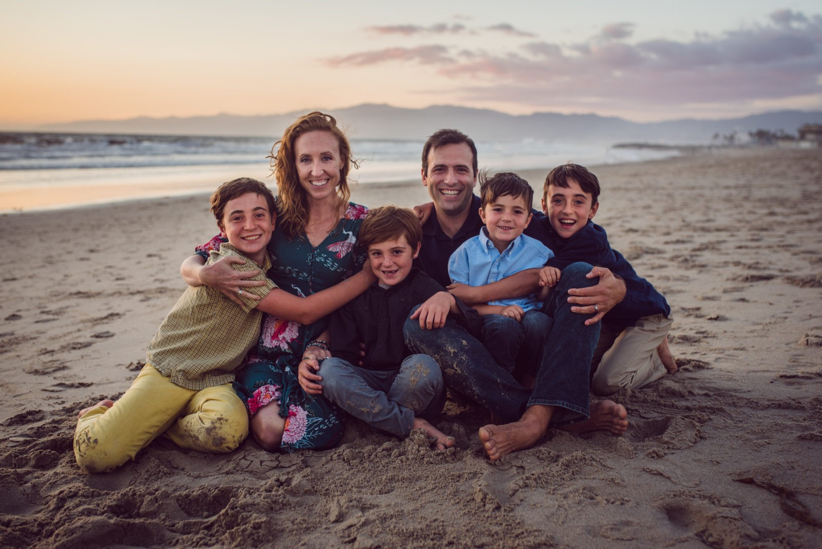 ArtShaped Photography colorfully captured this family of 4 boys while the sun sets on Venice Beach, California.