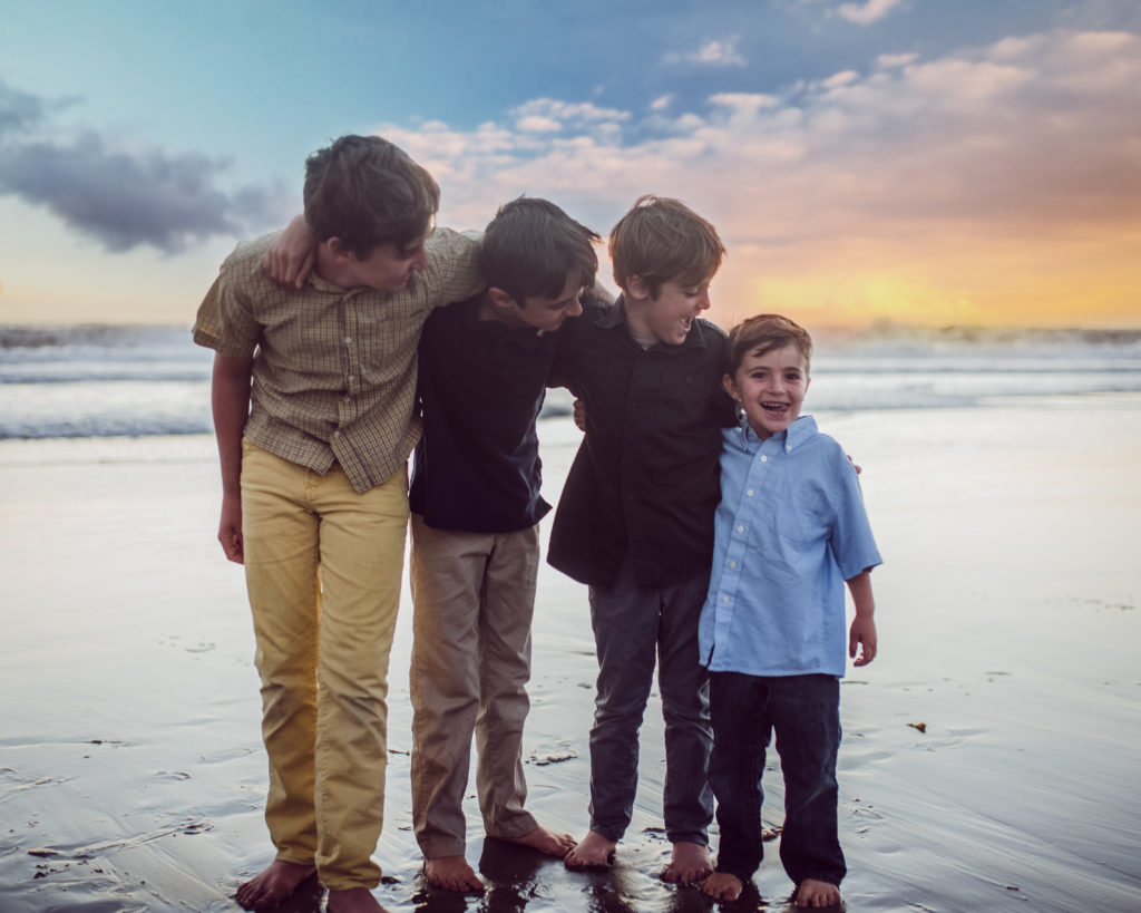 As colorful as the sunset these four boys playfully pose for Santa Monica based family photographer Artshaped Photography