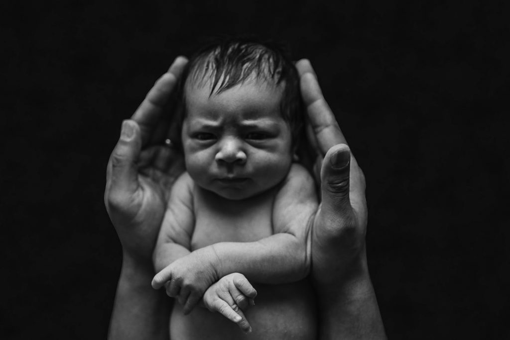 Black and white close up image of newborn session with ArtShaped Photography and Birth Services