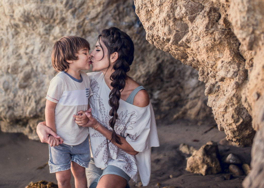 Colorful mother-son family mini session at El Matador State Beach. The sunset reflects the sunkissing bond between mom and her son during their session with Santa Monica based ArtShaped Photography and Birth Services
