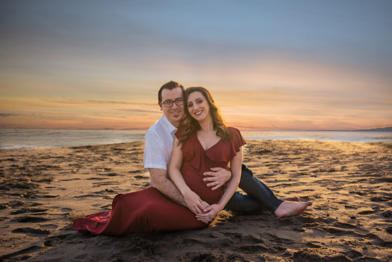 Spectacular winter sunsets are made for belly sessions at the beach as photographed by Los Angeles based photographer Diana Hinek for ArtShaped Photography and Birth Services